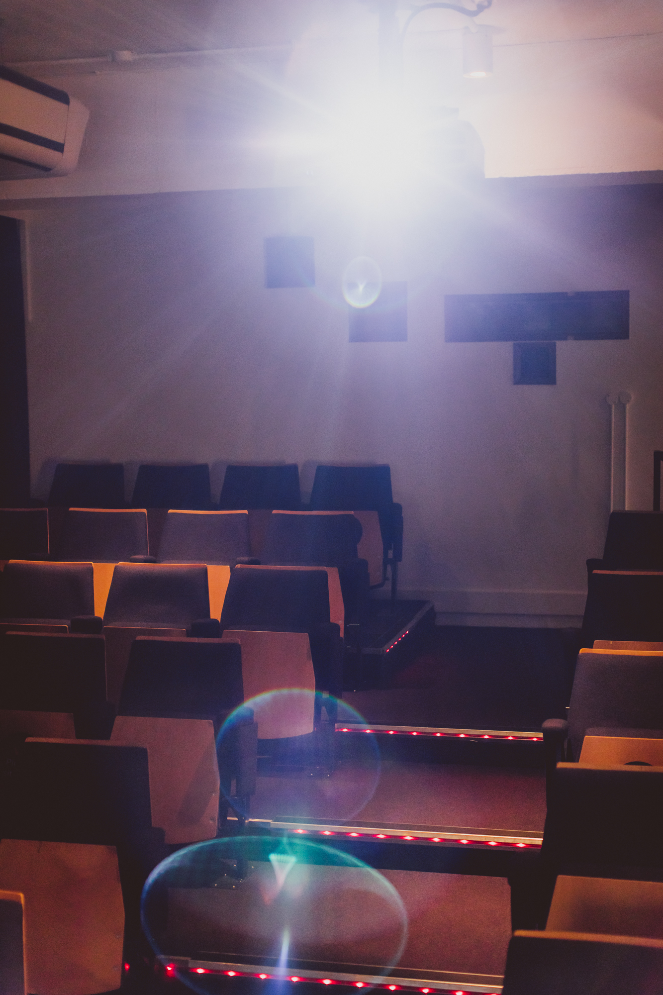 Seats and projector light in screening room