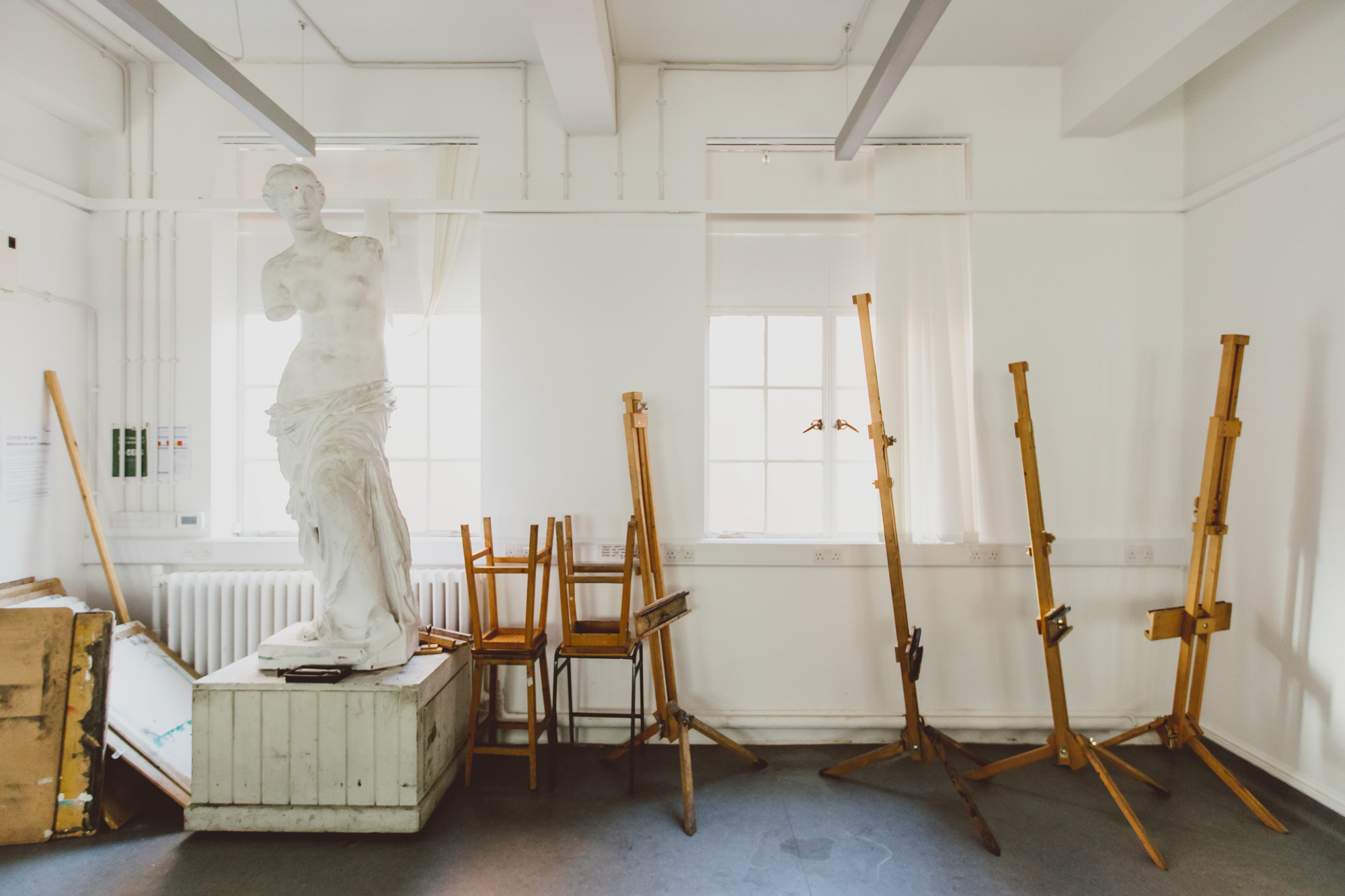 Statue and easels in life drawing room