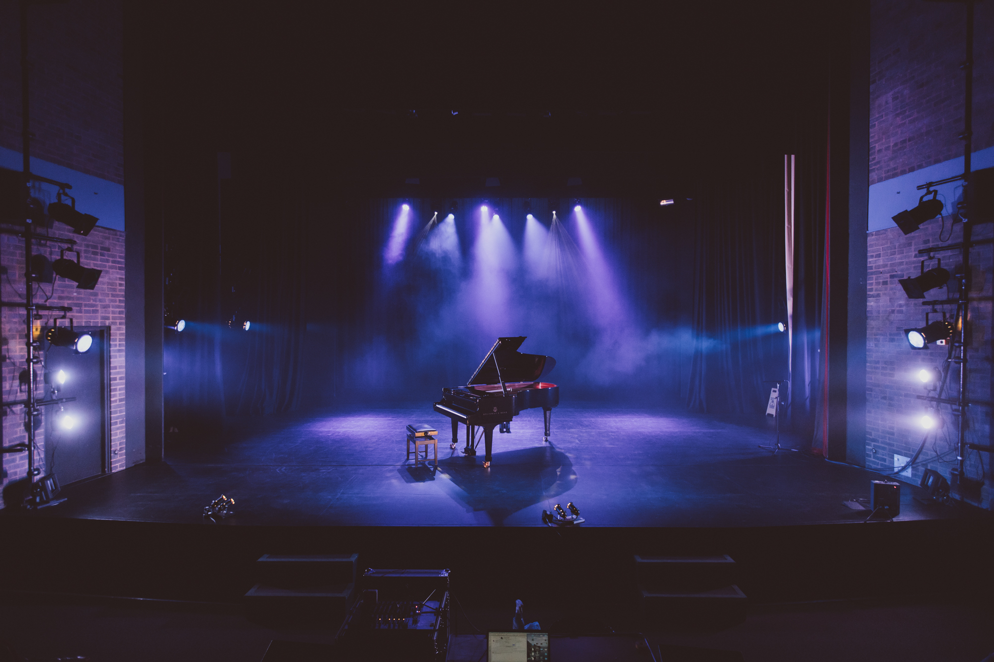 A piano onstage at Mumford Theatre