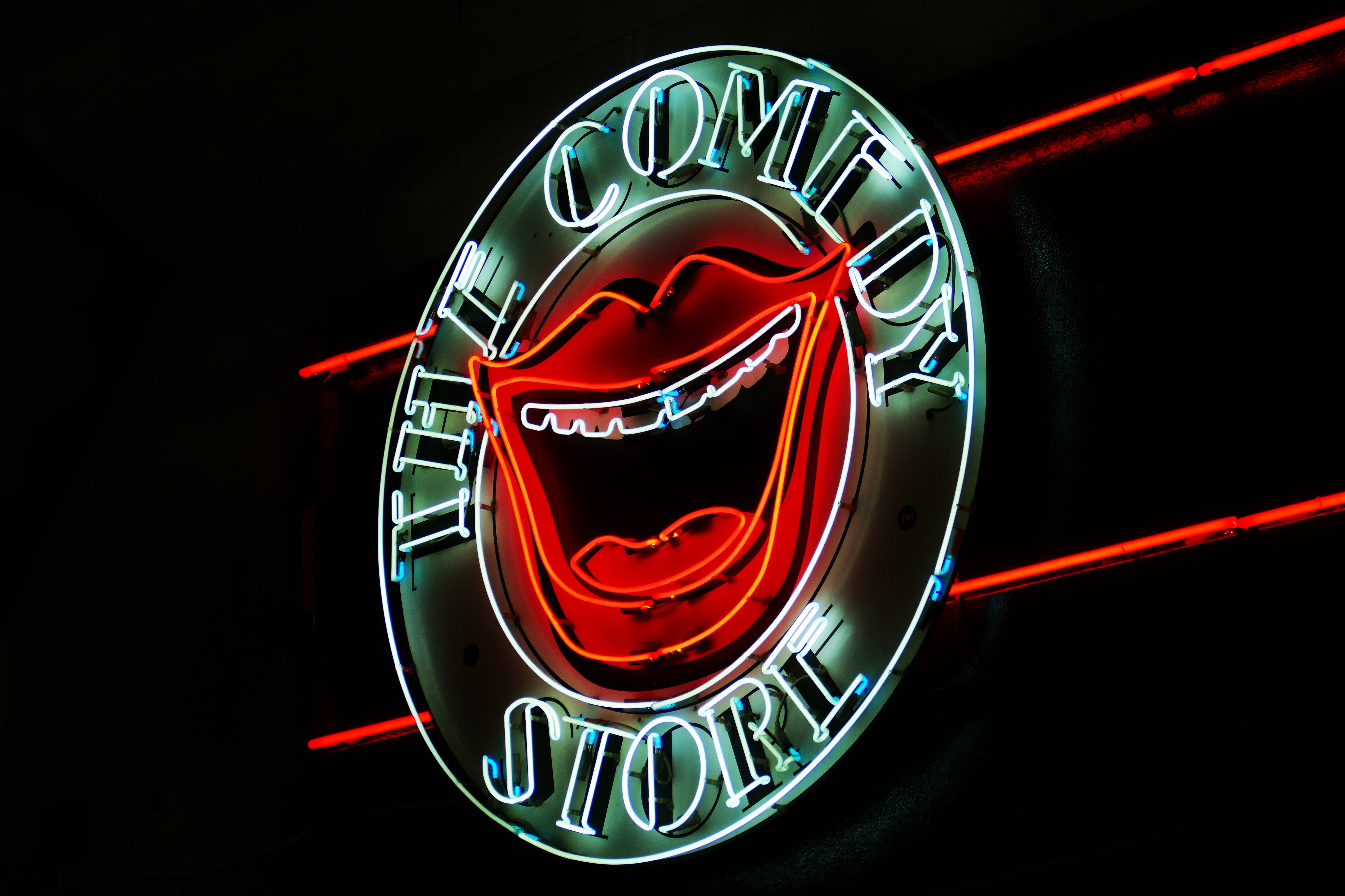 A light up wall decoration with the words The Comedy Store illuminated.
